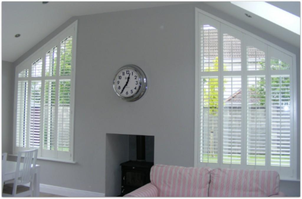 Shaped Plantation Shutters fitted to an angled window