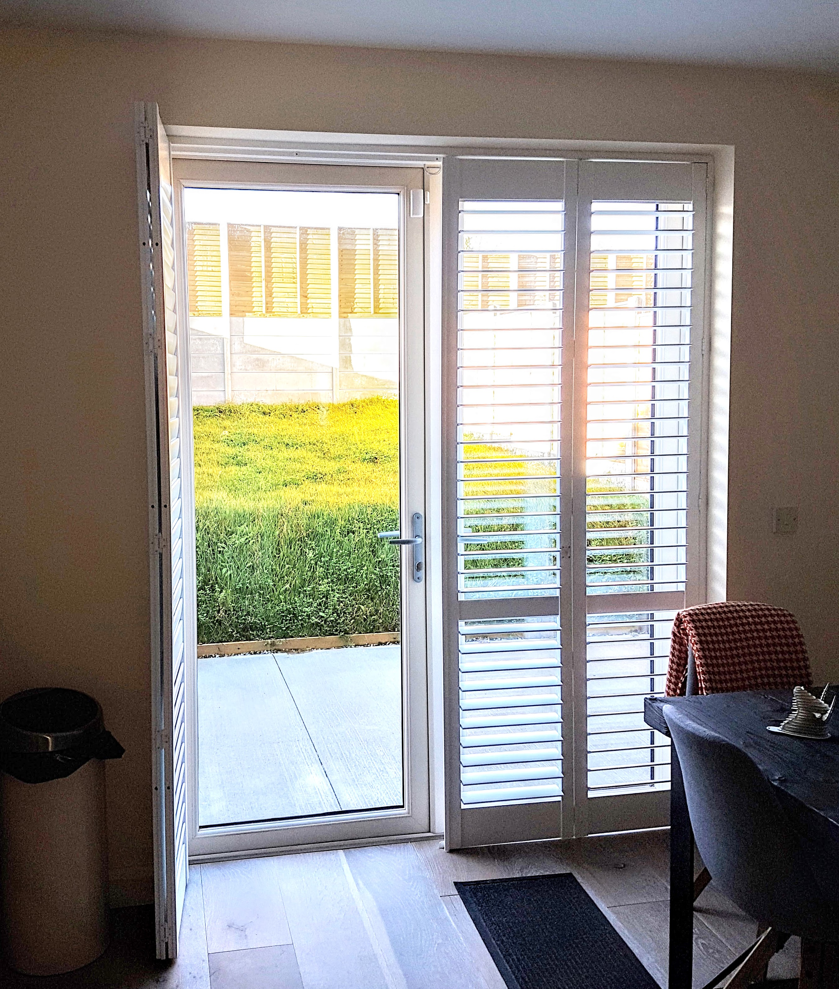 open plantation shutters doors