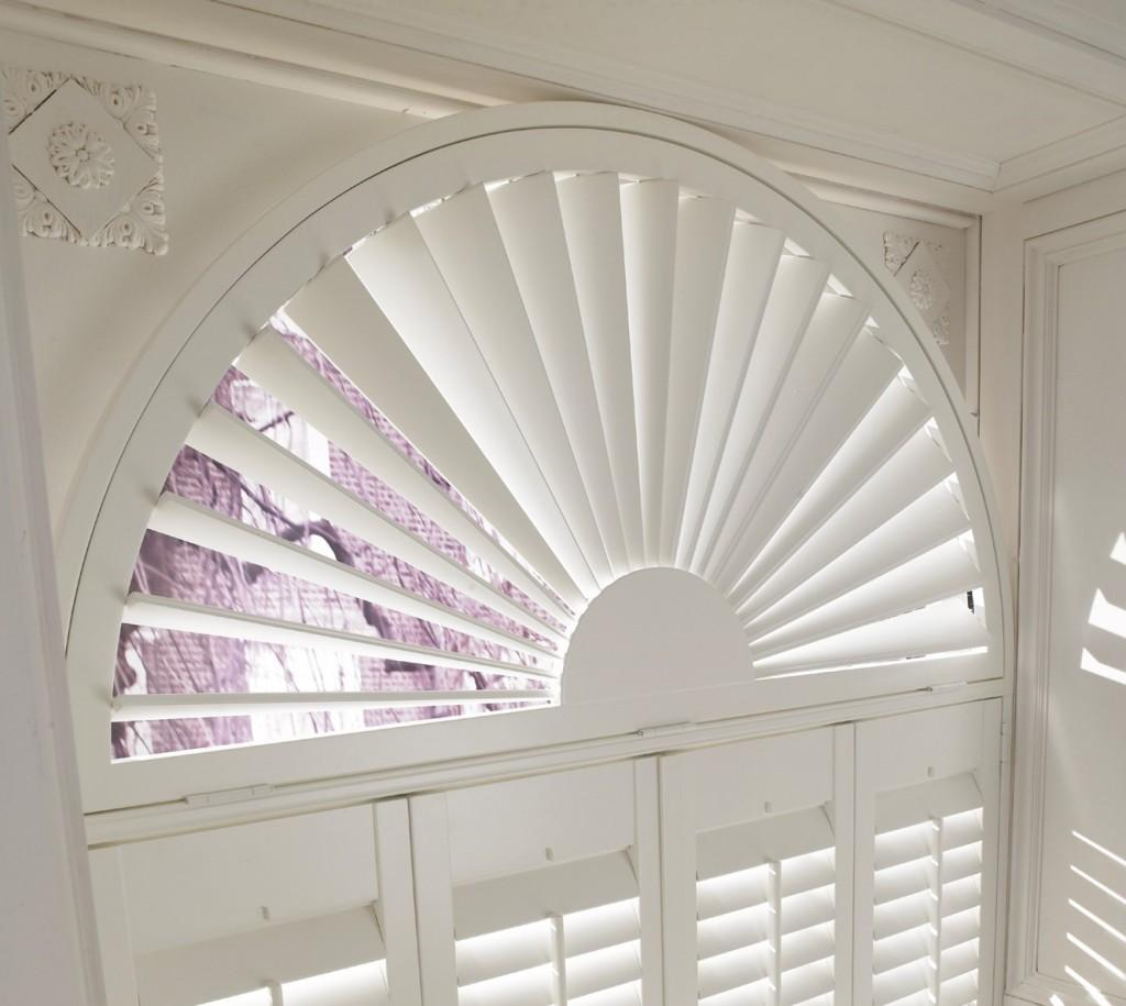Bay window plantation shutters shutters of dublin cork for Arched bay windows
